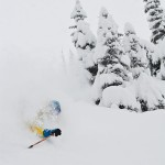 Greg Hill skiing deep deep powder at Rogers Pass.