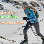 Janelle Smiley climbing on skis.