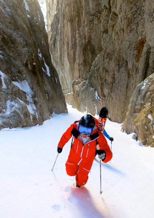 John booting up a couloir in France in his one piece Strafe suit.
