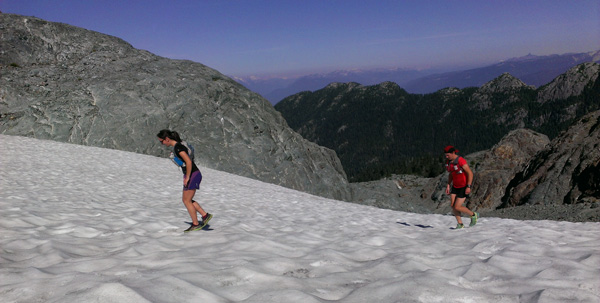 Girls running up the small glacier.
