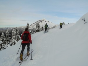 Skinning on the upper road with Garibaldi and Atwell Peaks in the background.