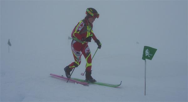 Lori Ann Donald striding through the thick fog. Photo Matt Reid.