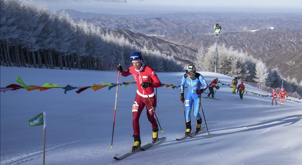 Top athletes fighting in cold conditions in the vertical race in Wanlong, China.